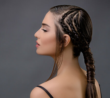 girl with african braid style with a sleek pony tail