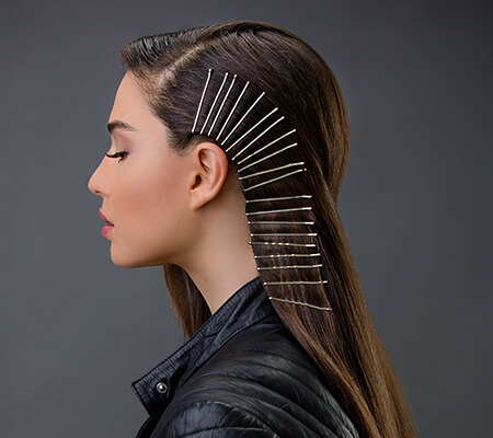 girl with sleek hair with bobby pins
