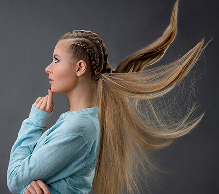 girl with braids and ponytail posing