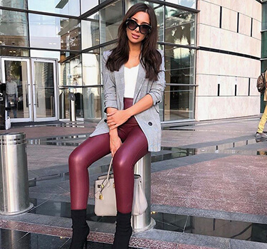 fashion blogger posing in red leather pants
